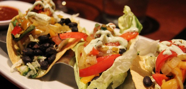 Vegetarian Black Bean and Roasted Pepper - Jalapeño-lime slaw, guacamole, pico de gallo, mole, salsa verde, cilantro sour cream (GLuten free with lettuce wrap and dairy free with sour  cream)