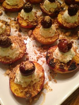 Grilled peaches with cherries, honey and goat cheese